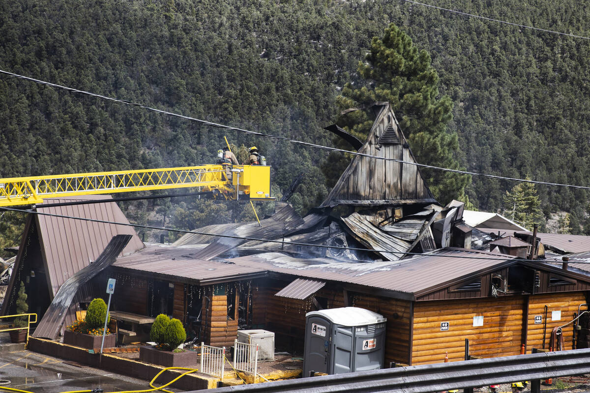The Clark County firefighters investigate the cause of a fire that damaged Mount Charleston Lod ...