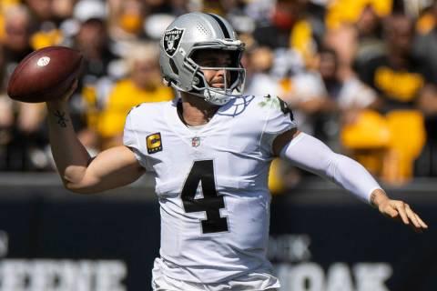 Raiders quarterback Derek Carr (4) makes a sideline pass with Pittsburgh Steelers cornerback Ja ...