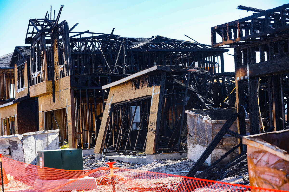 Remnants of a fire from last night at homes under construction by the company KB Home in southw ...