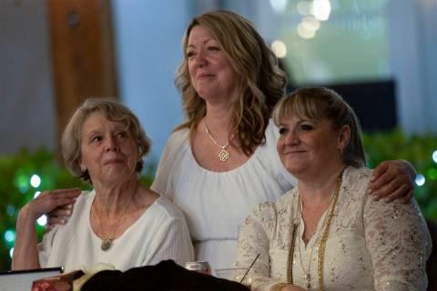 Ann Craig, left, Lynda Tache, and Allison Mack watch a sign language performance during the Nig ...