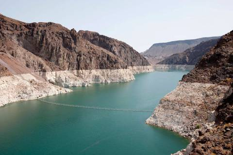 A bathtub ring of light minerals shows the high water line near Hoover Dam on Lake Mead in the ...