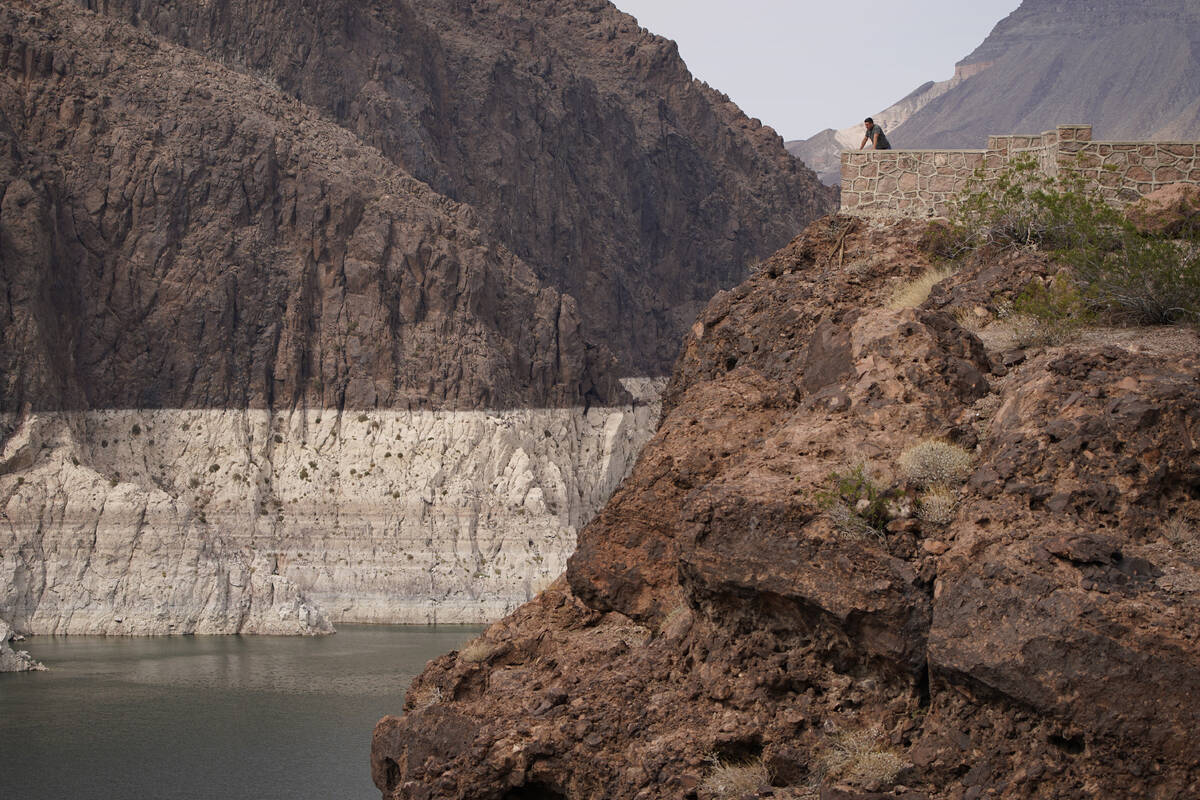 In this Aug. 13, 2021, file photo, a person looks out over Lake Mead near Hoover Dam at the Lak ...