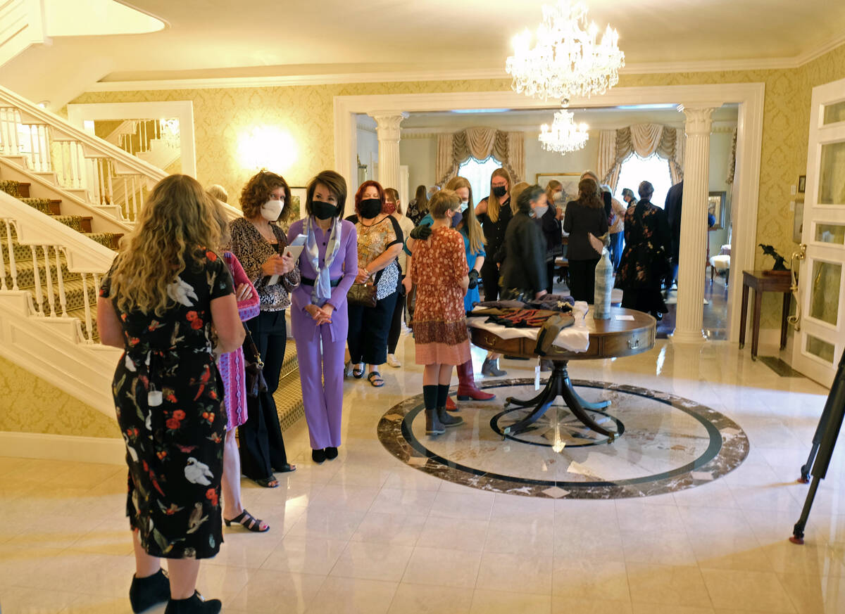 First Lady Kathy Sisolak speaks to guests at an opening reception and viewing of an art exhibit ...