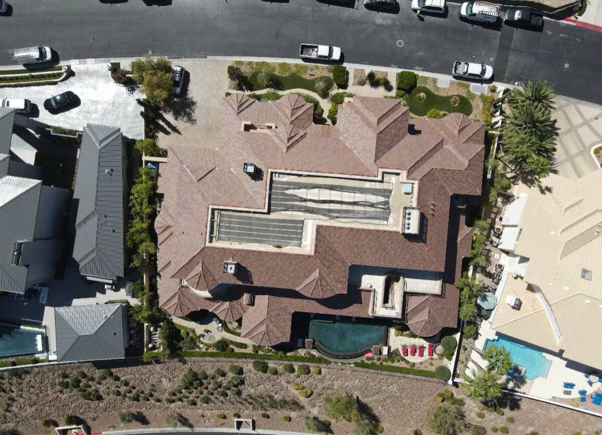 A drone image from early June 2021 shows solar panels in disrepair atop the home of Las Vegas i ...