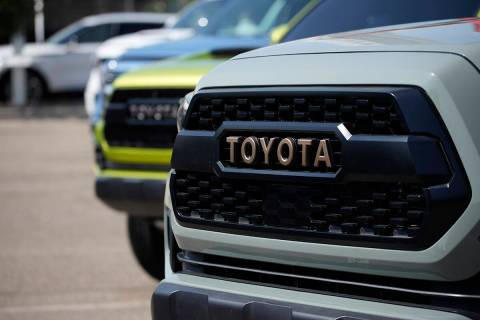 The company logo highlights the grille of a Tacoma pickup truck on display in the Toyota exhibi ...