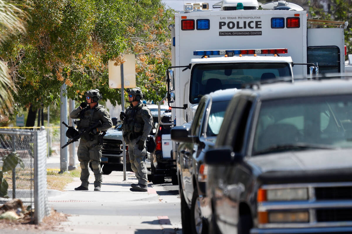 A heavy police presence is visible around the intersection of !0th Street and Lewis Avenue, Tue ...