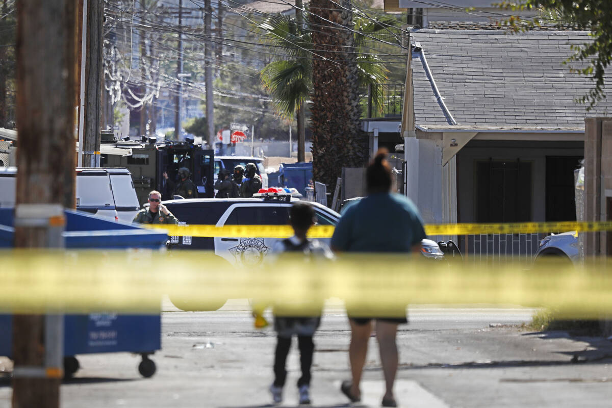 A heavy police presence is visible around a house in the 300 block of South 11th Street, Tuesda ...