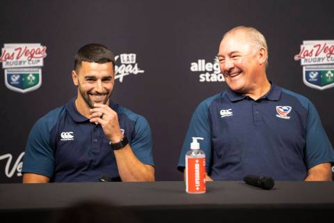 USA Eagles players Nate Augspurger, left, with USA Rugby's head coach Gary Gold, participate du ...