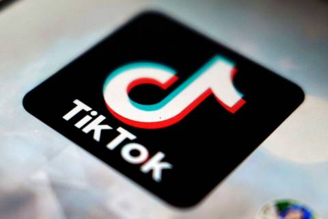 A logo of a smartphone app TikTok is seen on a user post on a smartphone screen. (AP Photo/Kiic ...