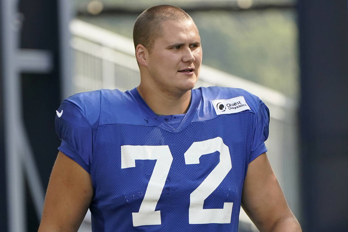 New York Giants offensive tackle Jackson Barton steps on the field at the start of an NFL footb ...