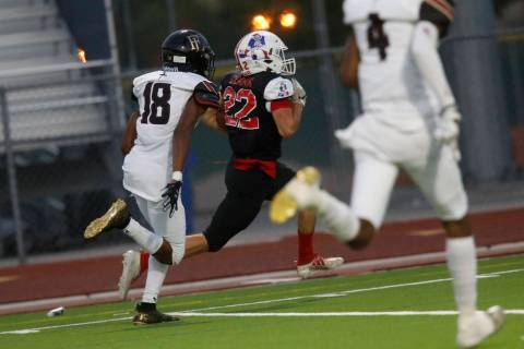 Liberty High School's Brody Clark (22) runs into the end zone for a touchdown during the first ...