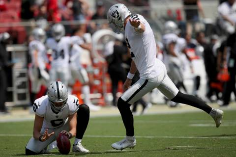Las Vegas Raiders kicker Daniel Carlson (2) in action as punter A.J. Cole (6) holds the ball du ...