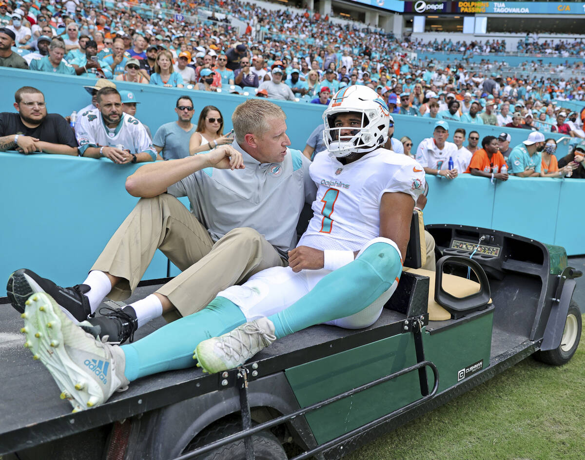 Miami Dolphins quarterback Tua Tagovailoa (1) carted out the field after getting injured in a p ...