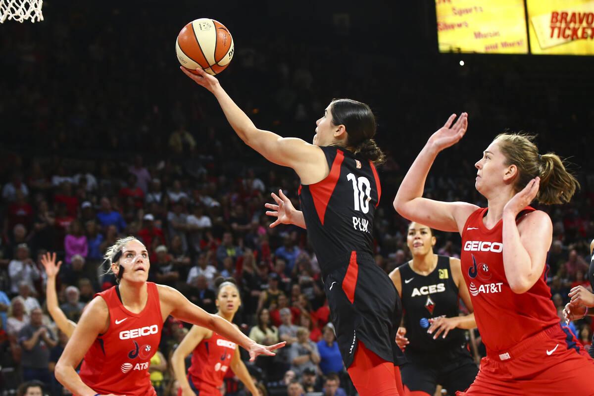 Las Vegas Aces' Kelsey Plum (10) goes to the basket past Washington Mystics' Emma Meesseman dur ...