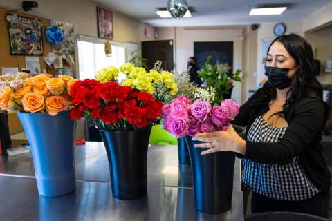 Theresa Arana, head florist at Chapel of the Flowers, arranges flowers, on Wednesday, Sep. 22, ...