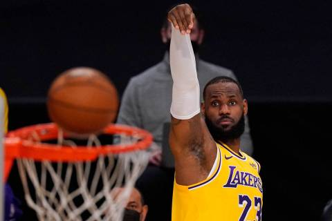 Los Angeles Lakers forward LeBron James shoots during the first half of an NBA basketball game ...