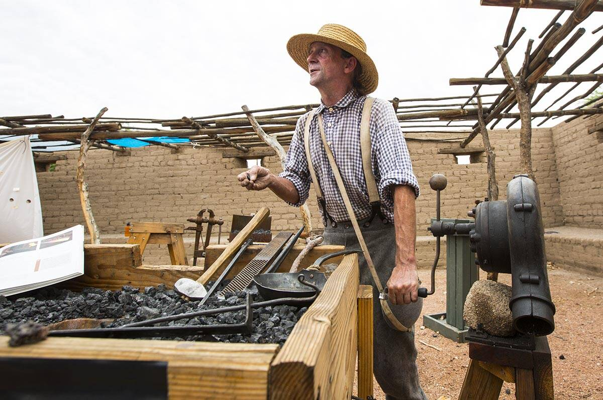 """Scott Elkins talks about blacksmithing during the """"Pioneer Day"""" event at the Old Las ..."""