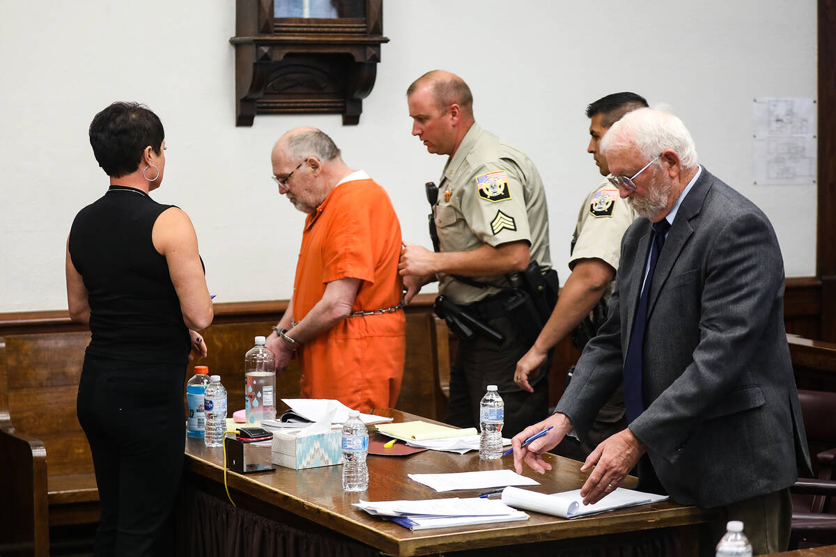 John Dabritz is led out of the courtroom after receiving a sentence of life in prison without p ...