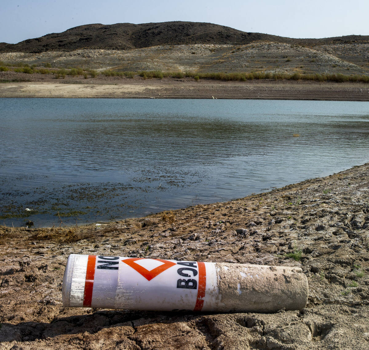 A buoy on the shore from low water near Boulder Harbor at Lake Mead National Recreation Area on ...