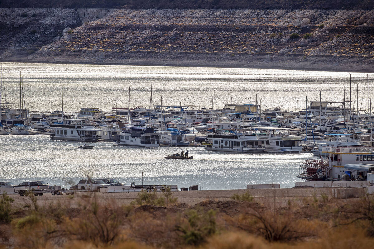 Boats cruise on a sunlit morning in Hemenway Harbor at the Lake Mead National Recreation Area o ...