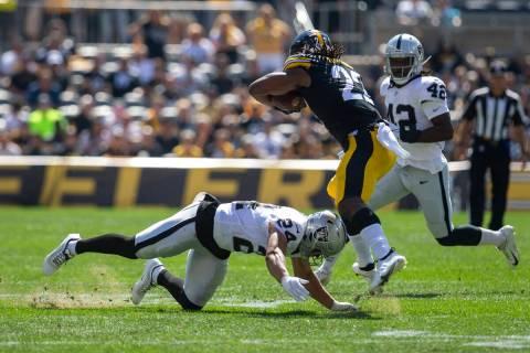 Raiders defensive back Johnathan Abram (24) tackles Pittsburgh Steelers running back Najee Harr ...