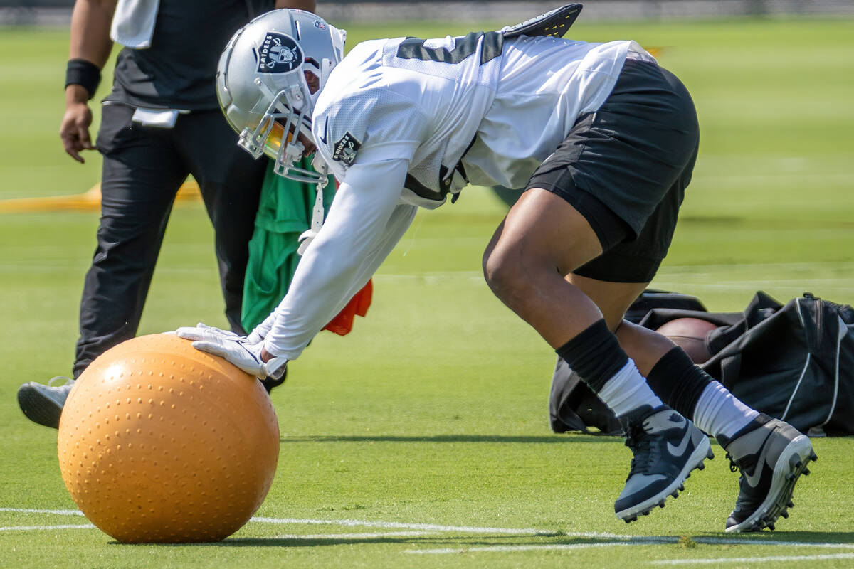 Raiders middle linebacker Denzel Perryman (52) pushes a medicine ball during practice at the In ...