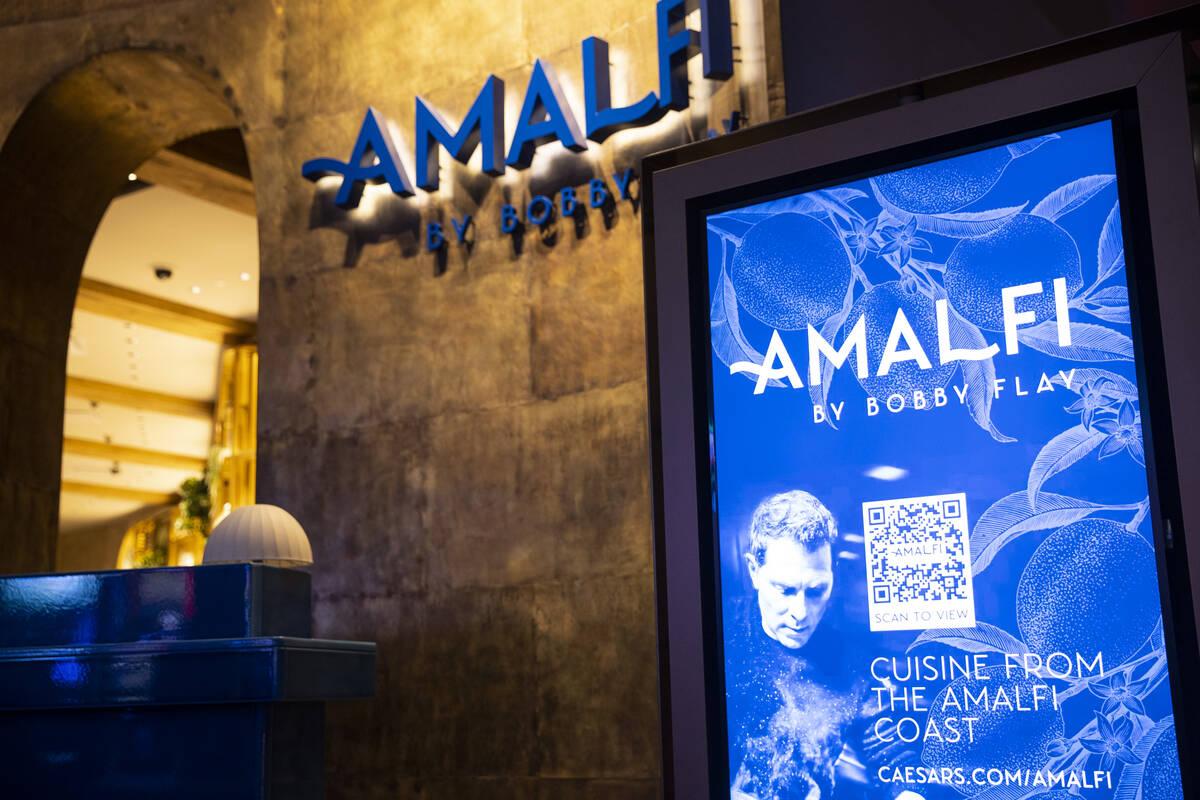 A sign displays QR code information to access the Amalfi restaurant menu at the Caesars Palace ...