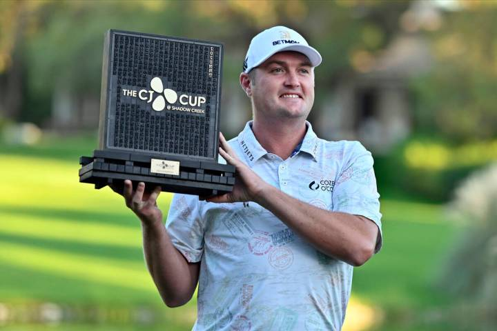 Jason Kokrak holds the championship trophy after winning the CJ Cup golf tournament at Shadow C ...