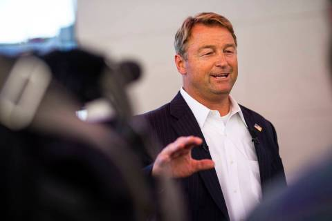 Former U.S. Sen. Dean Heller talks with members of the news media about his gubernatorial campa ...