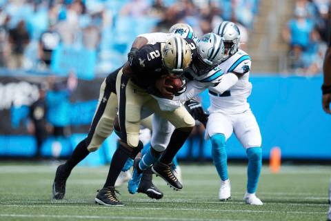 New Orleans Saints quarterback Jameis Winston (2) is sacked by Carolina Panthers defensive end ...