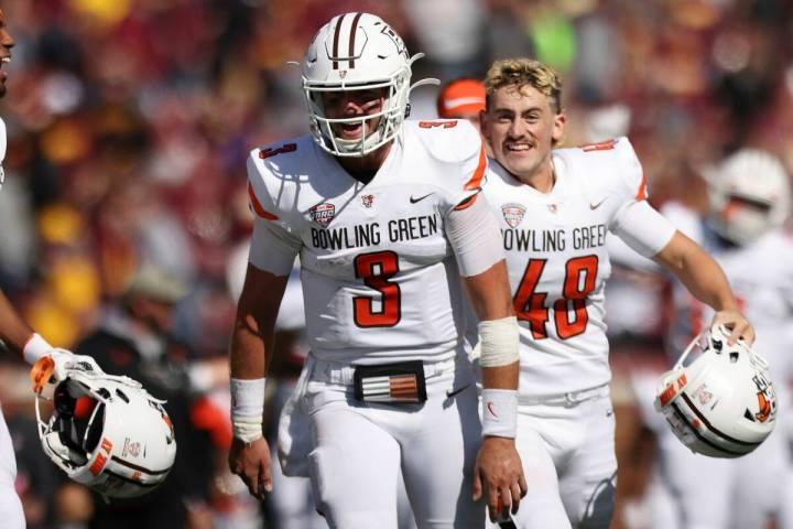 Bowling Green quarterback Matt McDonald (3) smiles in celebration after winning 14-10 against M ...