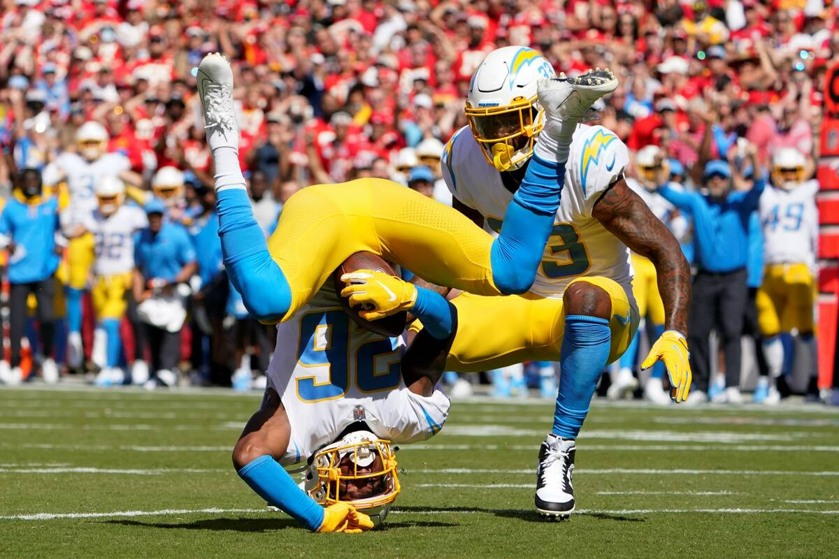 Los Angeles Chargers' Asante Samuel Jr. (26) makes an interception during the first half of an ...