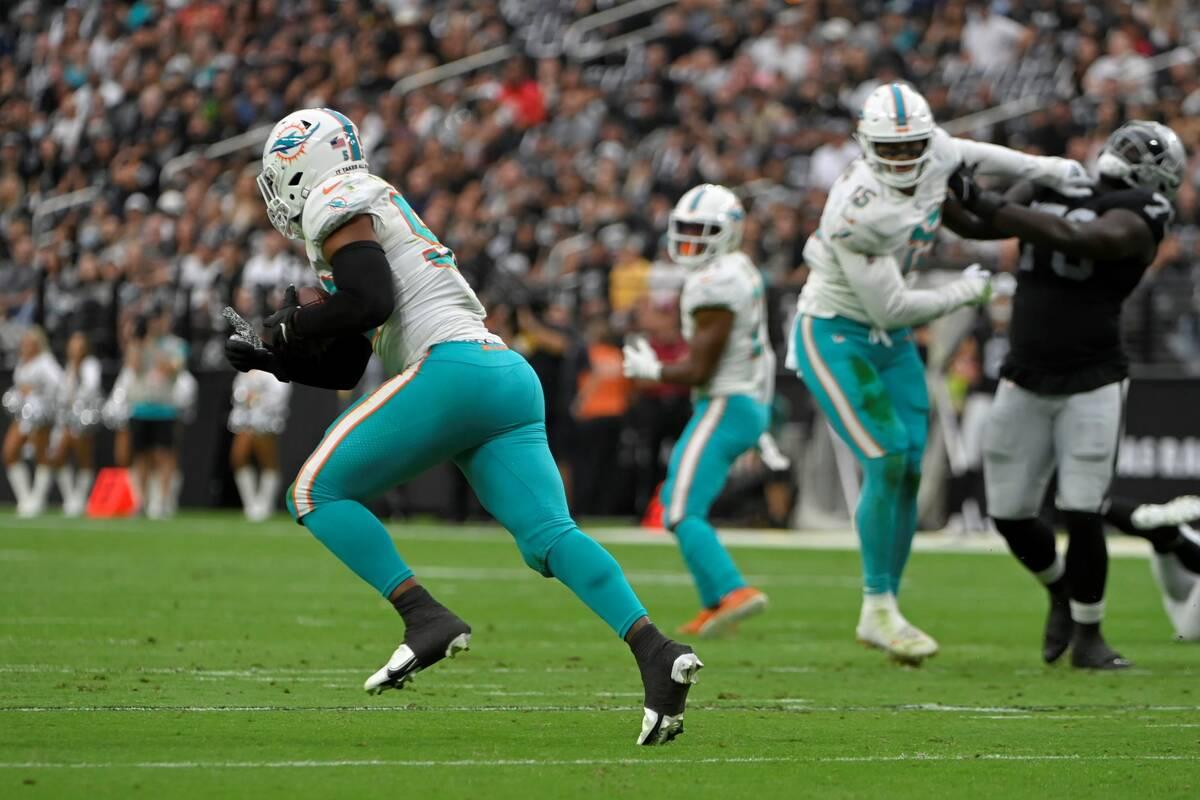 Miami Dolphins middle linebacker Elandon Roberts (52) makes an interception against the Las Veg ...