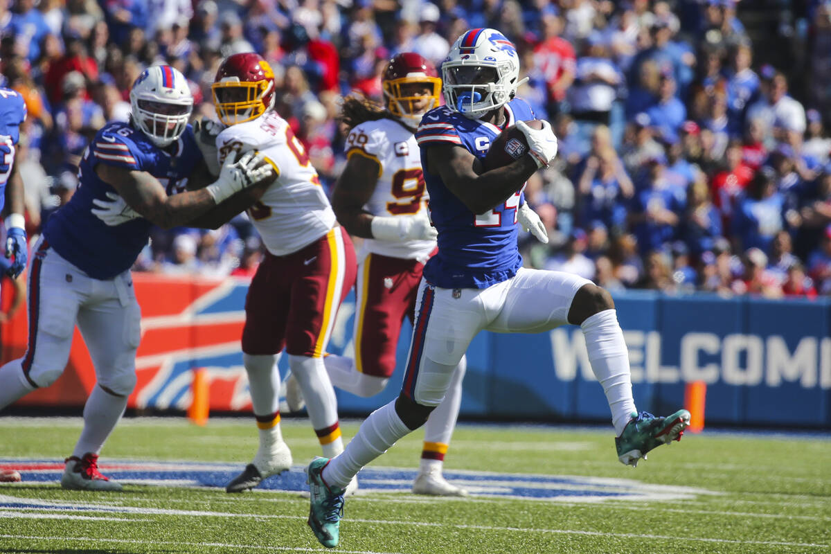 Buffalo Bills' Stefon Diggs (14) runs for yards after catch during the first half of an NFL foo ...