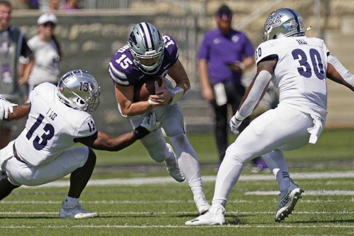 Kansas State quarterback Will Howard (15) runs between Nevada defensive back Jordan Lee (13) an ...