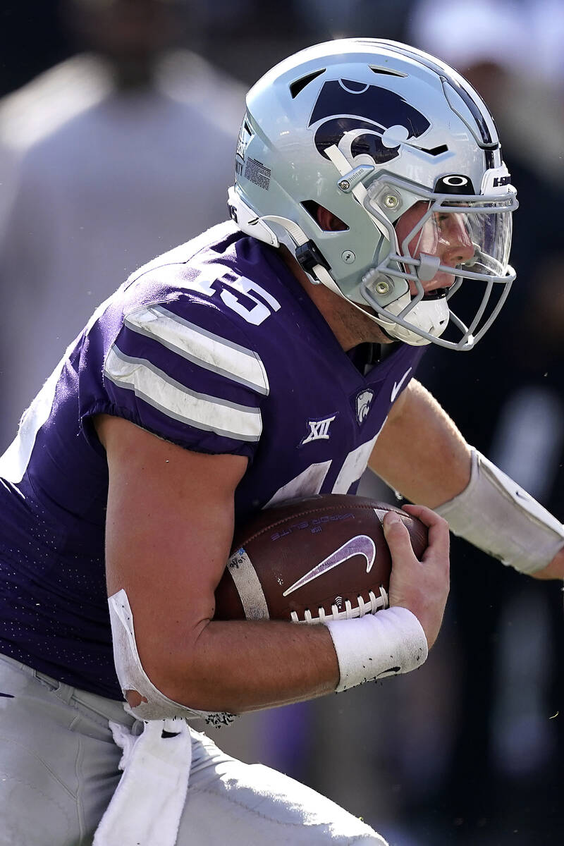 Kansas State quarterback Will Howard runs for a touchdown during the second half of an NCAA col ...