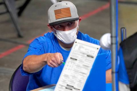 In this May 6, 2021, file photo, Maricopa County ballots cast in the 2020 general election are ...