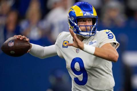 Los Angeles Rams quarterback Matthew Stafford (9) rthrows on the run during an NFL football gam ...