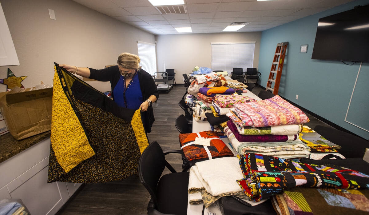 Lorea Arostegui, a victim advocate of the Vegas Strong Resiliency Center, looks through donated ...