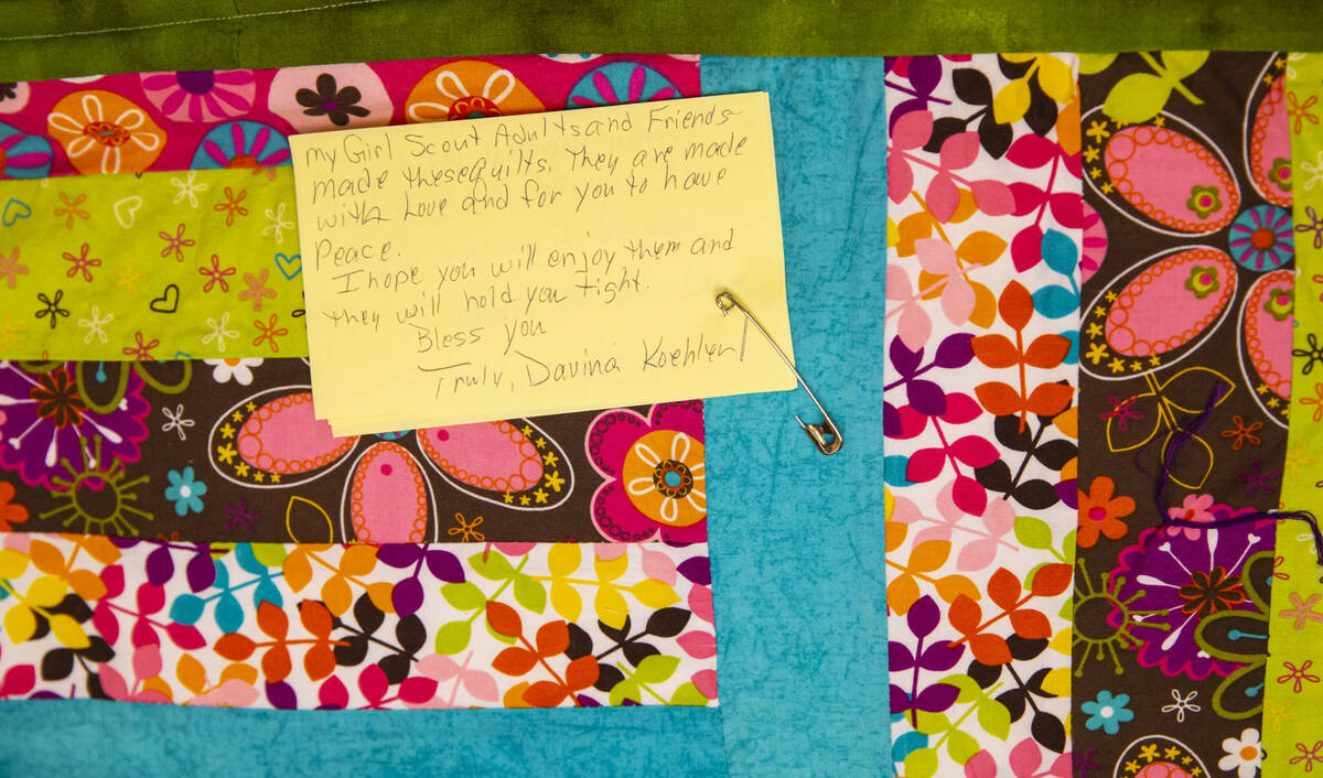 A donated quilt is seen from a group of Girl Scouts that will be given away to survivors, rela ...
