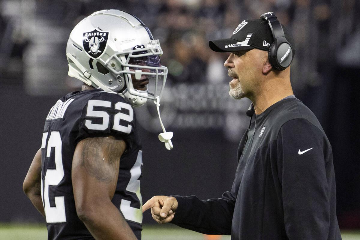 Raiders middle linebacker Denzel Perryman (52) hears from defensive coordinator Gus Bradley dur ...