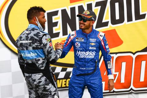 Bubba Wallace, left, congratulates Kyle Larson on his win in the NASCAR Cup Series Pennzoil 400 ...