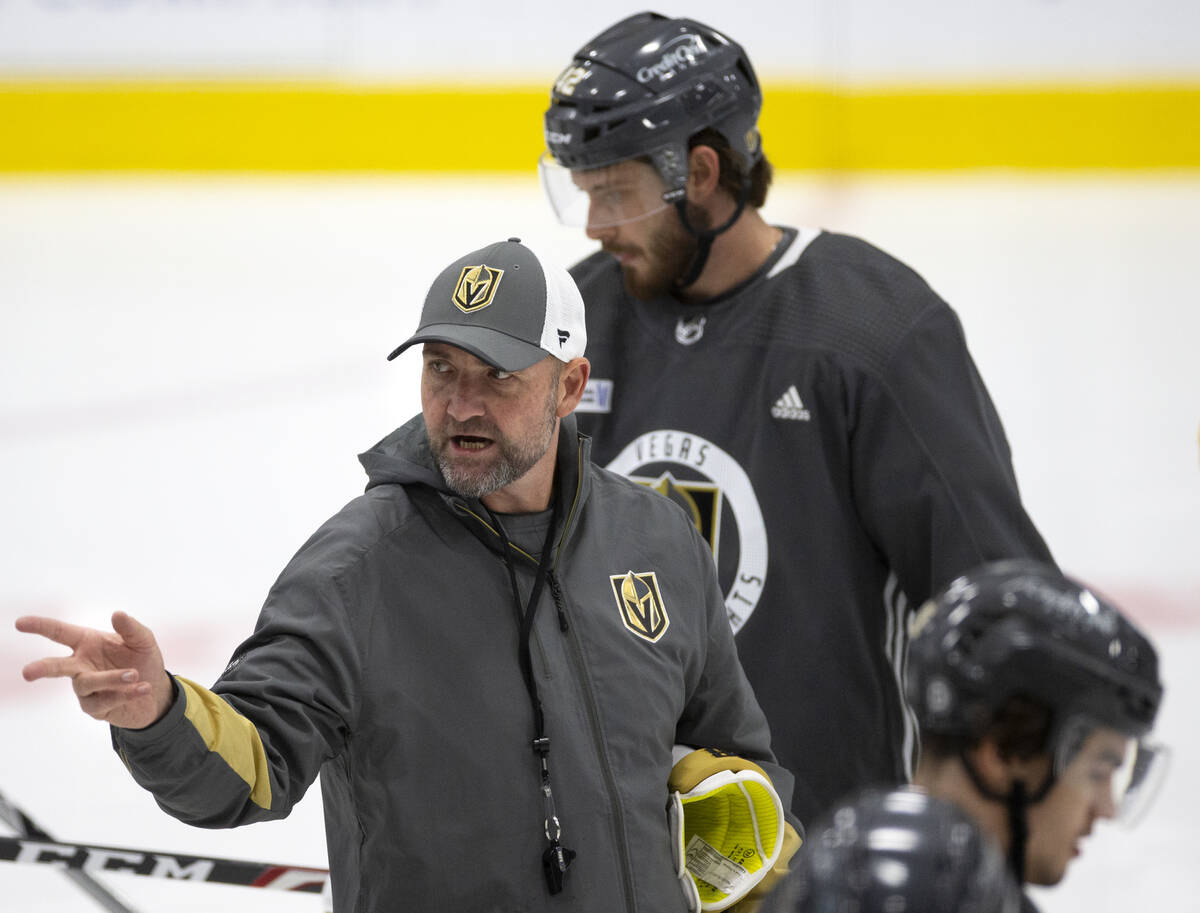 Head coach Peter DeBoer speaks to the team during a NHL hockey training camp practice at City N ...