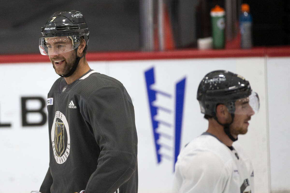 Golden Knights defenseman Alex Pietrangelo (7) and right wing Reilly Smith (19) laugh as they s ...