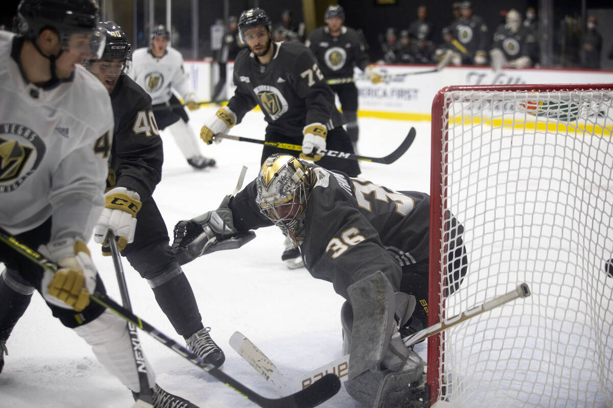 Golden Knights goaltender Logan Thompson (36) falls back as he lets a goal in the net during a ...