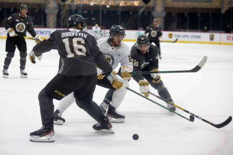 Golden Knights forward Lucas Elvenes (25) passes as forwards Pavel Dorofeyev (16) and Gage Quin ...