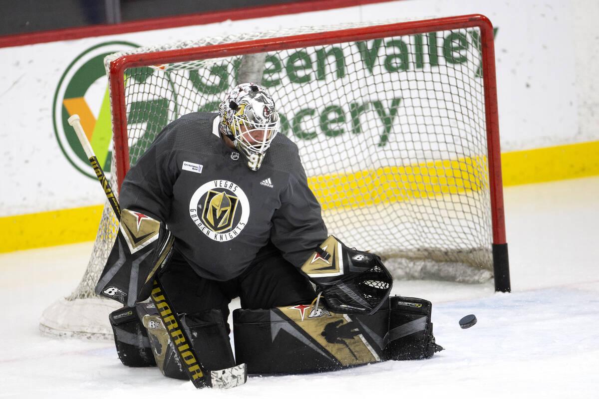 Golden Knights goaltender Robin Lehner (90) saves a shot during a NHL hockey training camp prac ...