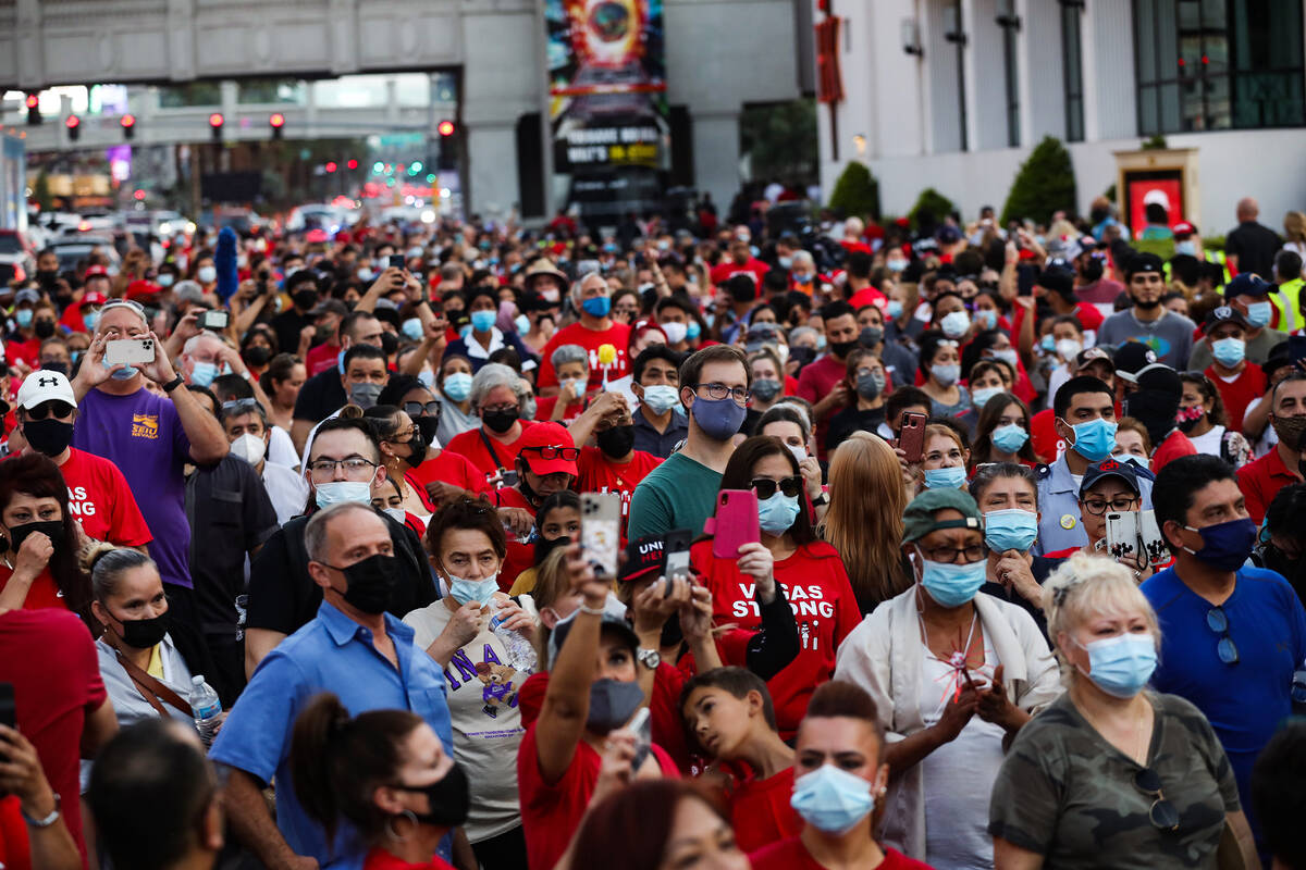 Members and supporters of the Culinary Workers Union Local 226 march on the Strip to bring atte ...