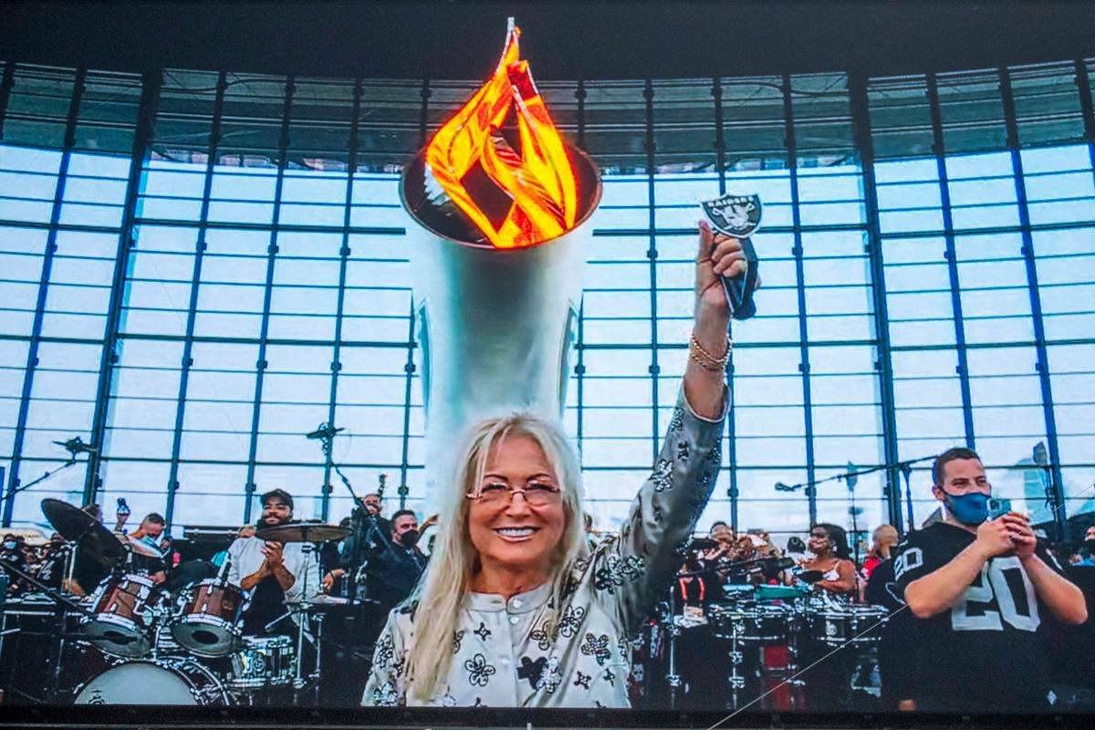 Dr. Miriam Adelson lights the Al Davis Memorial Torch Flame before the starts of a NFL preseaso ...