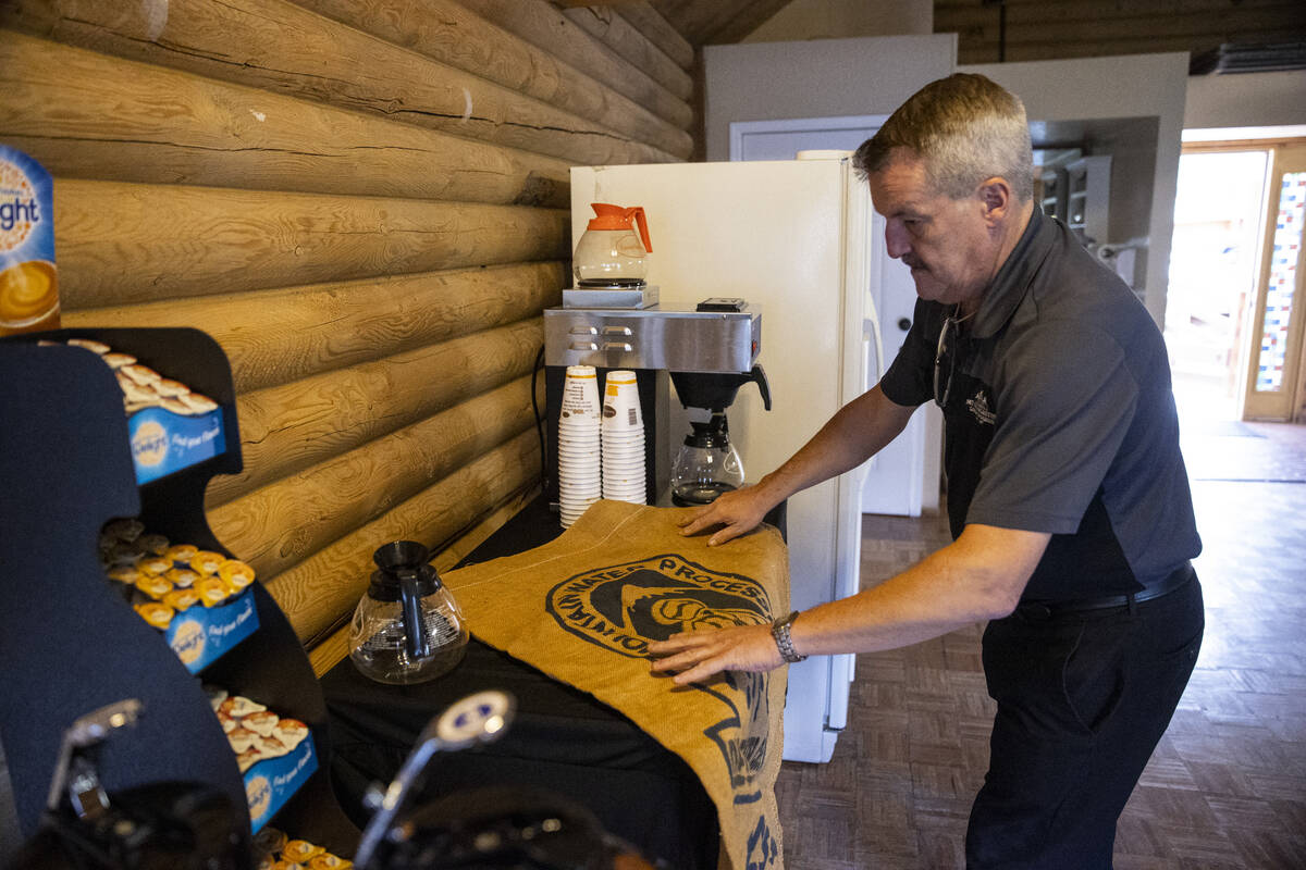 Operations manager Thomas Schnekloth sets up a coffee table at the Mt. Charleston Lodge in Las ...